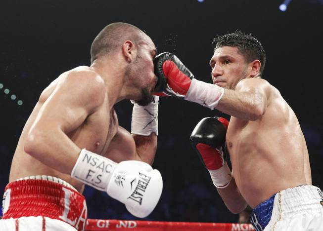 Arash Usmanee of Canada hits Ray Beltran of Mexico with a left during a 10-round lightweight fight at the MGM Grand Garden Arena on Saturday, April 12, 2014.