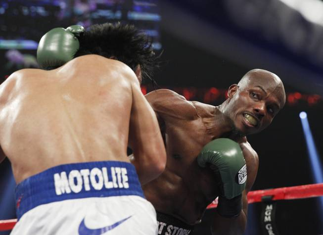 Manny Pacquiao, left, is hit with a right from undefeated WBO welterweight champion Timothy Bradley during their title fight at the MGM Grand Garden Arena on Saturday, April 12, 2014.
