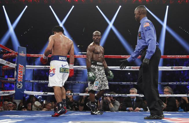 Undefeated WBO welterweight champion Timothy Bradley looks back at Manny Pacquiao between rounds in their title fight at the MGM Grand Garden Arena on Saturday, April 12, 2014.