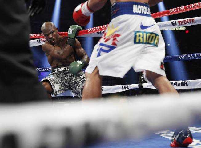 Manny Pacquiao knocks undefeated WBO welterweight champion Timothy Bradley into the ropes during their title fight at the MGM Grand Garden Arena on Saturday, April 12, 2014. Pacquiao won by unanimous decision.