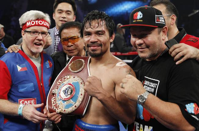 Manny Pacquiao of the Philippines celebrates his unanimous decision over WBO welterweight champion Timothy Bradley during their title fight at the MGM Grand Garden Arena on Saturday, April 12, 2014. Bradley was previously undefeated.