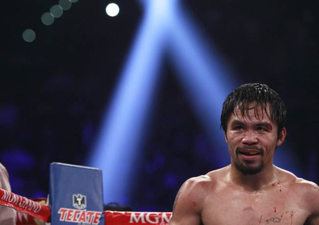 Manny Pacquiao heads to his corner between rounds of his title fight against Timothy Bradley at MGM Grand Garden Arena on Saturday, April 12, 2014. Pacquiao won a unanimous decision.