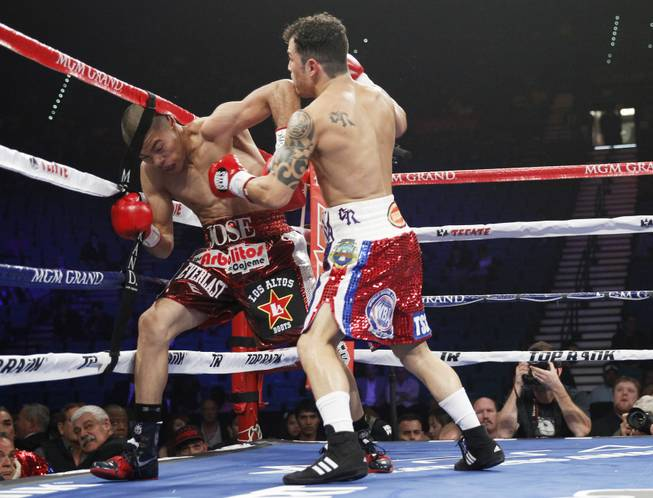 Jose Felix (left) of Mexico is forced into the ropes by Bryan Vazquez of Costa Rica during their WBA interim super featherweight fight at the MGM Grand Garden Arena on Saturday, April 12, 2014.