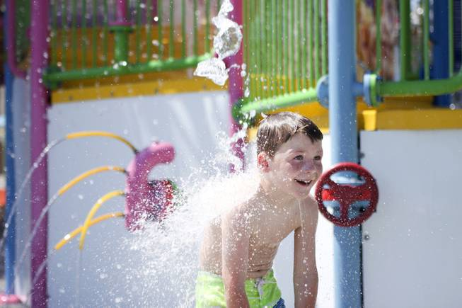 A boy enjoys the water fountains at the Kiddie Cove at Wet 'n' Wild during the first day of its weeklong spring break opening Saturday, April 12, 2014.