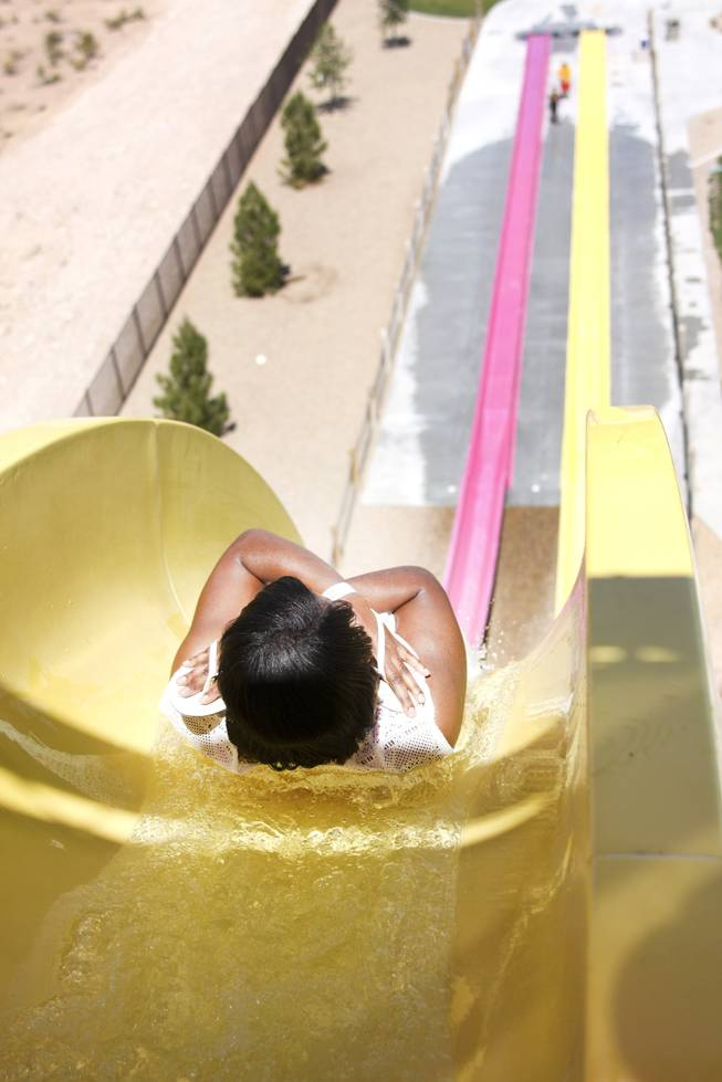 A woman goes down the Canyon Cliff slide at Wet 'n' Wild during the first day of its weeklong spring break opening Saturday, April 12, 2014.