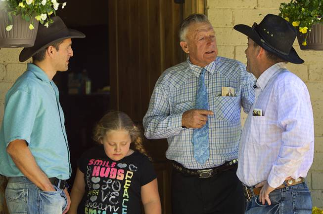 Cliven Bundy talks with family friend Rob Miller at the family ranch near Bunkerville Sunday, April 13, 2014. The Bureau of Land Management halted their roundup of Bundy family cattle under an agreement reached Saturday. David Lory VanDerBeek, an Independent American Party candidate for governor, looks on at left.