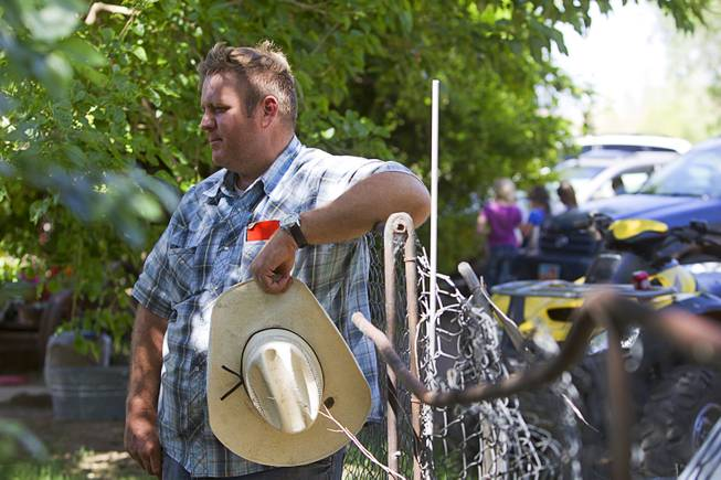 Dave Bundy, one of Cliven Bundy's son's, rests against a fence at the family ranch near Bunkerville Sunday, April 13, 2014. The BLM halted their roundup of Bundy family cattle under an agreement reached Saturday.
