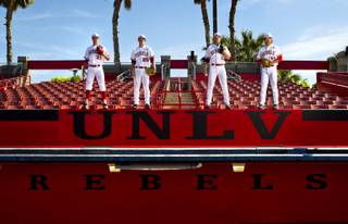 UNLV baseball pitchers Erick Fedde, 20, Kenny Oakley, 25, Bryan Bonnell,11, and John Richy, 45, at the Earl E. Wilson Stadium on Thursday, April 10, 2014.
