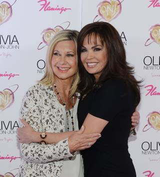 "Olivia Newton-John and Marie Osmond walk the pink carpet at the grand opening of Newton-John's show ""Summer Nights"" at the Flamingo on Friday, April 11, 2014, in Las Vegas."