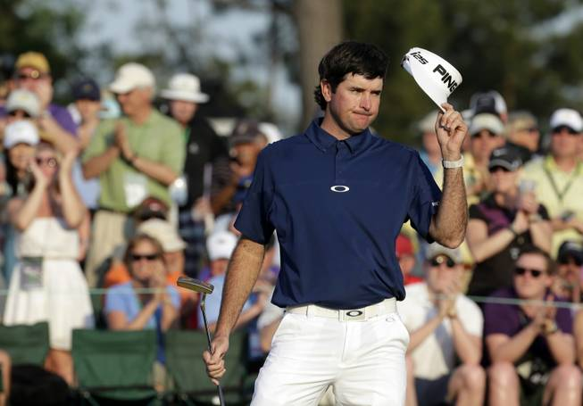 Bubba Watson tips his cap after putting on the 18th green during the third round of the Masters golf tournament Saturday, April 12, 2014, in Augusta, Ga.