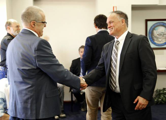 Kevin Bowe, a movie production consultant, hands with hearing officer Brad Mamer during a Nevada Economic Development Commission hearing at the Sawyer State Building Monday, April 14, 2014.  A production company called LPF One DTIG LLC and affiliated with the Downtown Project is applying for a tax incentive for a proposed movie production starring Dakota Fanning that will be filmed in Las Vegas.