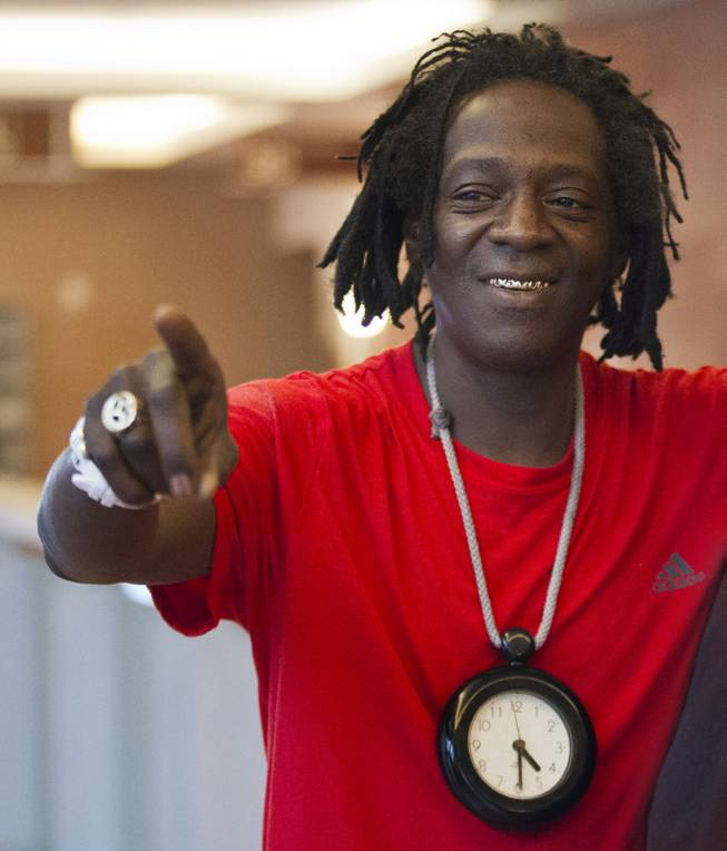 William Jonathan Drayton, Jr., aka Flavor Flav, is all smiles after receiving probation for a misdemeanor battery charge at the Regional Justice Center on Monday, April 14, 2014.