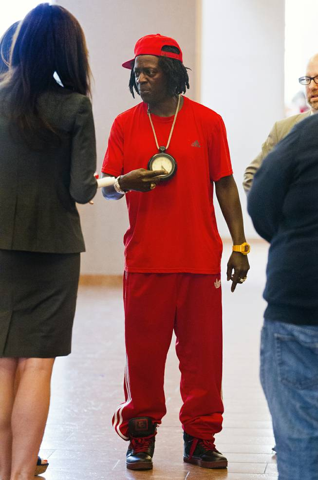 William Jonathan Drayton, Jr., aka Flavor Flav, talks with his legal staff appears following his appearance before Judge Kathy Hardcastle at the Regional Justice Center on Monday, April 14, 2014.