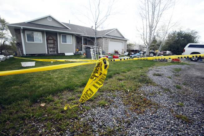 Pleasant Grove Police investigate the scene where  seven infant bodies were discovered and packaged in separate containers at a home in Pleasant Grove, Utah, Sunday, April 13, 2014.  According to the Pleasant Grove Police Department, seven dead infants were found in the former home of Megan Huntsman, 39. Huntsman was booked into jail on six counts of murder. (AP Photo/Deseret News, Jeffrey D. Allred) MANDATORY CREDIT