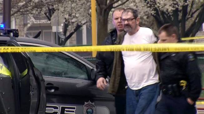 In this Sunday, April 13, 2014 image from video provided by KCTV-5, Frazier Glenn Cross, also known as Frazier Glenn Miller, is escorted by police in an elementary school parking lot in Overland Park, Kan. Cross, 73, accused of killing three people in attacks at a Jewish community center and Jewish retirement complex near Kansas City, is a known white supremacist and former Ku Klux Klan leader who was once the subject of a nationwide manhunt.