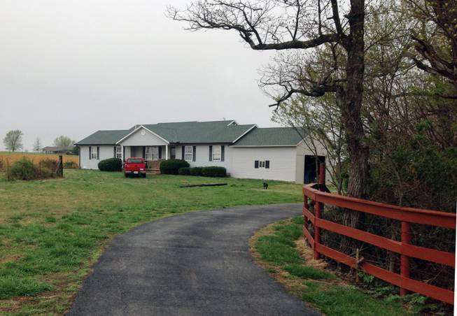 This April 14, 2014 photo shows the Aurora, Mo. home of Frazier Glenn Cross. Cross, 73, is accused of killing three people in attacks at a Jewish community center and Jewish retirement complex on Sunday near Kansas City. He was booked into Johnson County jail on a preliminary charge of first-degree murder after the attacks in Overland Park.