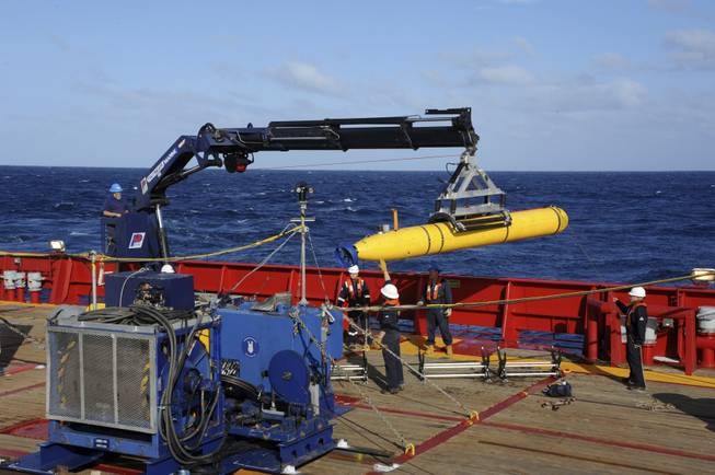 In this April 1, 2014, file photo, provided by the U.S. Navy, the Bluefin 21 autonomous sub is hoisted back on board the Australian Defense Vessel Ocean Shield after successful buoyancy testing in the Indian Ocean, as search efforts continued for missing Malaysia Airlines Flight 370.