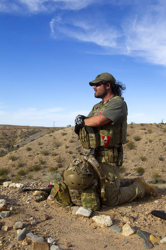 Reid Hendricks of Camden, Tenn. takes up a position on a hill by Cliven Bundy's ranch near Bunkerville Tuesday, April 15, 2014. Hendricks is a former Marine (honorably discharged), and has worked as a police officer and a high school history teacher, he said.