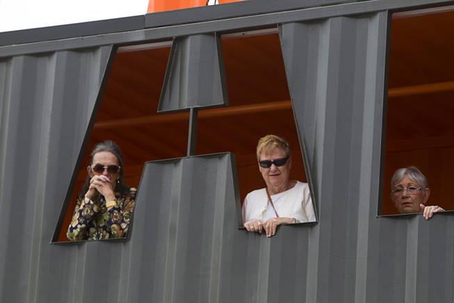 Henderson residents, from left, Vernette Langley, Gay Fleming, and Billie Means, watch as Senate Majority Leader Harry Reid (D-NV) talks with reporters at Las Vegas Container Park Tuesday, April 15, 2014.