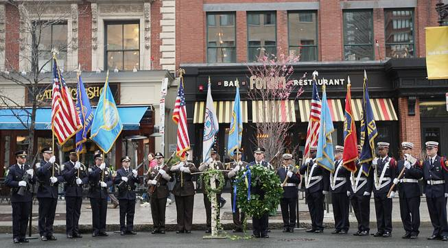 Honor Guard members line up in front of the Forum Restaurant in Copley Square, where a wreath laying ceremony was held to commemorate the one year anniversary of the Boston Marathon bombings, Tuesday, April 15, 2014. (AP Photo/The Boston Globe, Wendy Maeda)  BOSTON HERALD OUT, QUINCY OUT; NO SALES