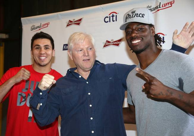 "Michael King, center, president of King Sports, stands with heavyweight boxers Charles Martin and Alex Flores during a weigh-in Tuesday, April 15, 2014, in Santa Monica, Calif., for Wednesday's ""Boxing at Baker"" at the Baker Hangar in Santa Monica."