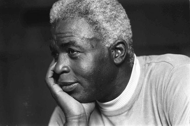 In this June 30, 1971, file photo, Jackie Robinson poses at his home in Stamford, Conn. Baseball holds tributes across the country on Jackie Robinson Day, Tuesday, April 15, 2014, the 67th anniversary marking the end of the game's racial barrier.