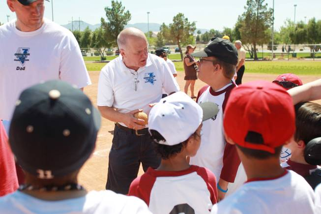 Tom Taycher talks to players on the Loan Writers team as Silverado Little League hosts Challenger Little League day Saturday, April 12, 2014.