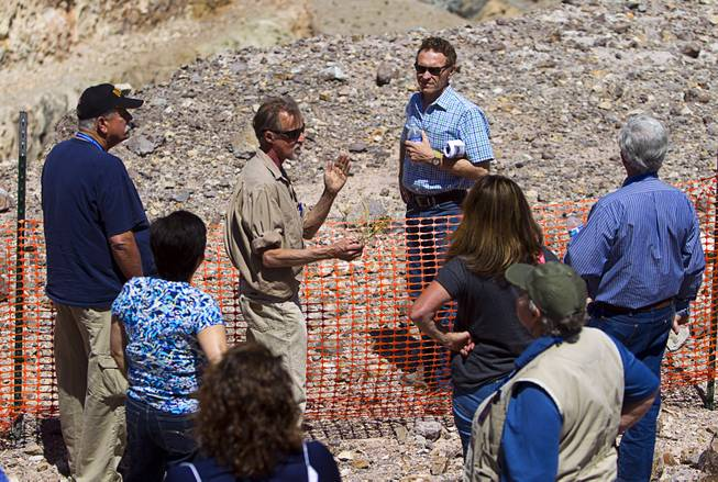 Christopher Ross, center, a senior field scientist with Robsin Engineering, and a member of Barrick's Education Committee, speaks during the 25th Annual Southern Nevada Earth Science Education Workshop Wednesday, April 16, 2014. The tour included a trip to include a visit to the Barrick's Bullfrog Mine and the ghost town of Rhyolite. Teachers spent the first day of the workshop focused on classroom activities related to rocks and minerals.
