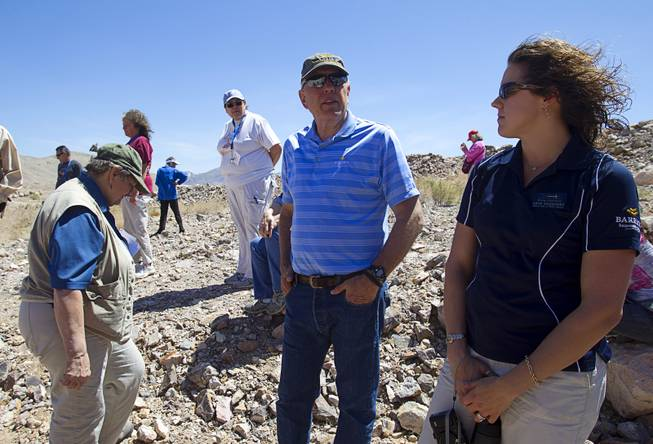Barrick's Russ Jones, center, talks with teachers at the new Bullfrog Mine near Beatty during the 25th Annual Southern Nevada Earth Science Education Workshop Wednesday, April 16, 2014. The gold and silver mine was in operation from 1988 to 1999. The tour also included a trip the ghost town of Rhyolite. Teachers spent the first day of the workshop focused on classroom activities related to rocks and minerals.