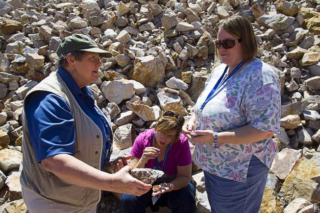 Daohne LaPointe, left, a member of the Nevada Mining Association, talks about rocks with Delta Academy teacher Jennifer Harnden, right, and Meadows School teacher Kimberly Cagle during the 25th Annual Southern Nevada Earth Science Education Workshop Wednesday, April 16, 2014. The tour included a trip to include a visit to the Barrick's Bullfrog Mine and the ghost town of Rhyolite. Teachers spent the first day of the workshop focused on classroom activities related to rocks and minerals.
