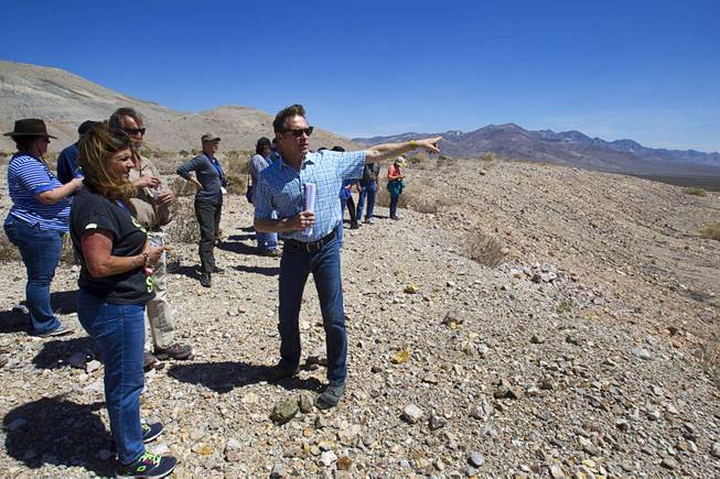 Barrick's Tim Buchanan points out features of the new Bullfrog Mine near Beatty during the 25th Annual Southern Nevada Earth Science Education Workshop Wednesday, April 16, 2014. The gold and silver mine was in operation from 1988 to 1999. The tour also included a trip the ghost town of Rhyolite. Teachers spent the first day of the workshop focused on classroom activities related to rocks and minerals.