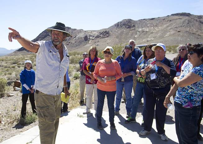 Karl Olson, the self-declared Mayor of Ryholite, talks with teachers about the history of the mining town during the 25th Annual Southern Nevada Earth Science Education Workshop Wednesday, April 16, 2014. The tour also included a visit to the Barrick's Bullfrog Mine. Teachers spent the first day of the workshop focused on classroom activities related to rocks and minerals.