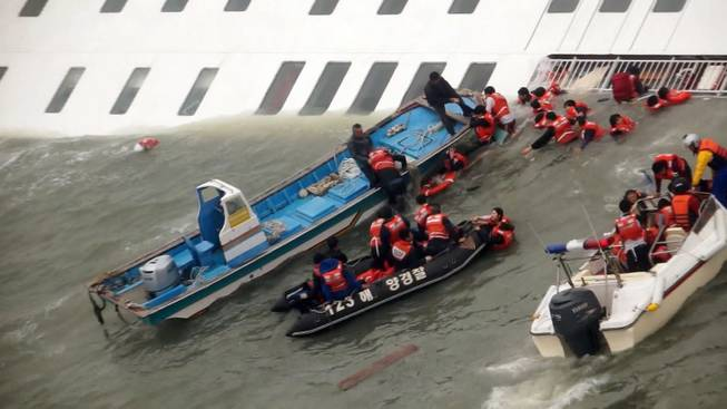 In this image taken from video from Mokpo Coast Guard, passengers from a ferry sinking off South Korea's southern coast, are rescued by South Korean Coast guard in the water off the southern coast near Jindo, south of Seoul, Wednesday, April 16, 2014. Nearly 300 people were still missing Wednesday several hours after the ferry carrying 477, most of them high school students, sank in cold waters off South Korea's southern coast.