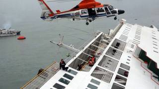 In this image taken from video released by News Y via Yonhap, passengers from a ferry sinking off South Korea's southern coast, are rescued by a South Korean Coast Guard helicopter in the water off the southern coast near Jindo, south of Seoul, Wednesday, April 16, 2014. Nearly 300 people were still missing Wednesday several hours after the ferry carrying 477, most of them high school students, sank in cold waters off South Korea's southern coast.