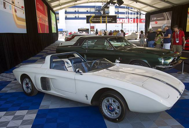 A 1962 Ford Mustang I roadster concept car is displayed during the Mustang 50th Birthday Celebration at the Las Vegas Motor Speedway Thursday, April 17, 2014. The celebration continues through Sunday.