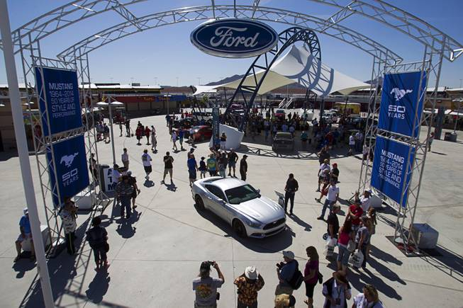 A 2015 Ford Mustang is displayed during the Mustang 50th Birthday Celebration at the Las Vegas Motor Speedway Thursday, April 17, 2014. The redesigned Mustang is expected to be available in late 2014. The celebration continues through Sunday.