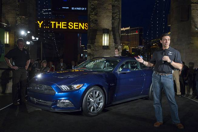 Mark Fields (R), chief operating officer for Ford Motor Company, speaks in front of a 2015 50 Year Limited Edition Mustang outside the New York-New York Thursday April 17, 2014. The unveiling was part of the Mustang 50th Birthday Celebration taking place at the Las Vegas Motor Speedway. Ford announced that they will build 1,964 of the 50-Year Limited Edition model.