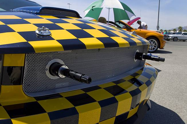 A customized late-model Mustang with fake machine guns is displayed during the Mustang 50th Birthday Celebration at the Las Vegas Motor Speedway Thursday, April 17, 2014.