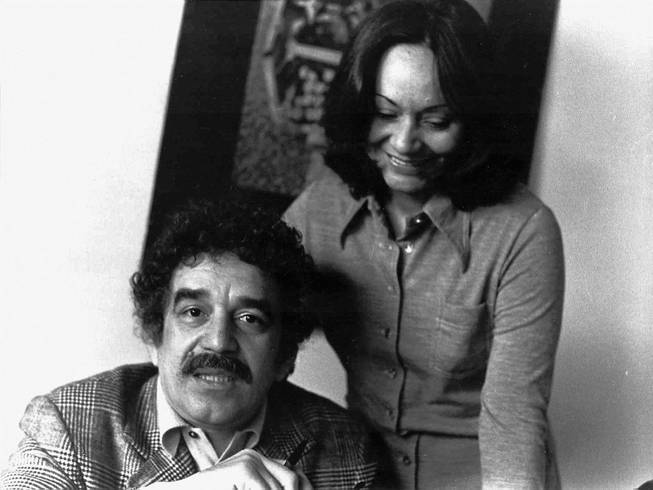 In this 1975 photo released by the Fundacion Nuevo Periodismo Iberoamericano (FNPI), Colombian author Gabriel Garcia Marquez sits with wife Mercedes Barcha at an unknown location. The Nobel laureate died on Thursday, April 17, 2014 at his home in Mexico City. His magical realist novels and short stories exposed tens of millions of readers to Latin America's passion, superstition, violence and inequality. The FNPI was founded by Garcia Marquez.