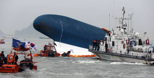 South Korean Coast Guard officers try to rescue missing passengers from a sunken ferry in the water off the southern coast near Jindo, south of Seoul, South Korea, Thursday, April 17, 2014. Fears rose Thursday for the fate of more than 280 passengers still missing more than 24 hours after their ferry flipped onto its side and filled with water off the southern coast of South Korea.