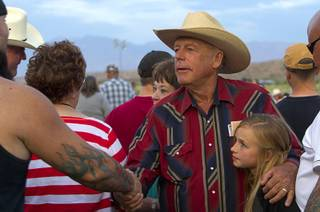 Rancher Cliven Bundy greets supporters during a Bundy family