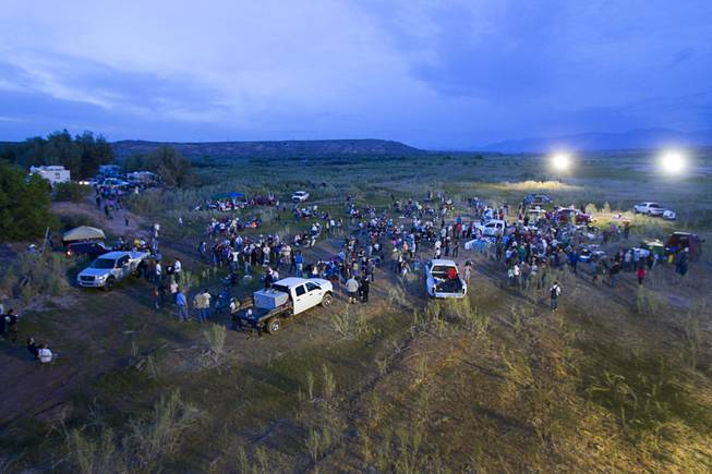"Supporters of rancher Cliven Bundy attend a ""Patriot Party"" near Bunkerville Friday, April 18, 2014. The Bundy family organized the party to thank people who supported Cliven Bundy in his dispute with the Bureau of Land Management."