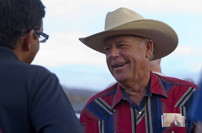 "Rancher Cliven Bundy, right, greets a supporter during a Bundy family ""Patriot Party"" near Bunkerville on Friday, April 18, 2014. The family organized the party to thank people who supported Bundy in his dispute with the Bureau of Land Management."