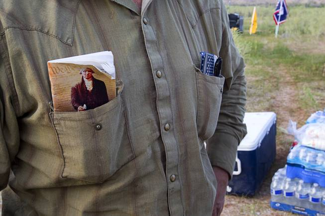 "Ryan Bundy, son of rancher Cliven Bundy, carries a copy of the U.S. constitution in his shirt pocket during a Bundy family ""Patriot Party"" near Bunkerville Friday, April 18, 2014. The family organized the party to thank people who supported rancher Cliven Bundy in his dispute with the Bureau of Land Management."