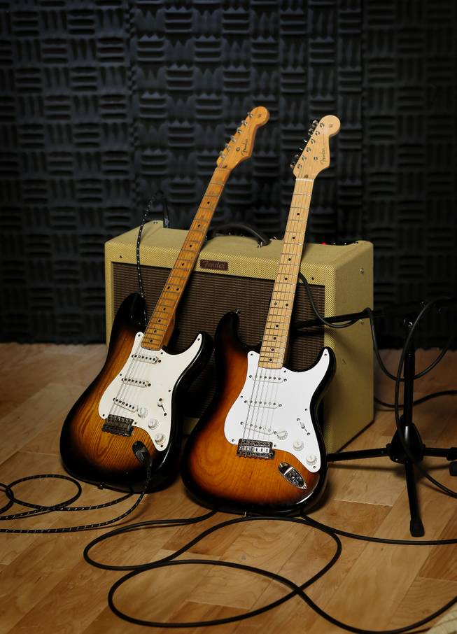 An original 1954 Fender Stratocaster, left, is shown next to a 2014 model at a studio in Scottsdale, Ariz. on Friday, Jan. 10, 2014. Leo Fender developed the instrument in a small workshop in Fullerton, Calif. six decades ago.