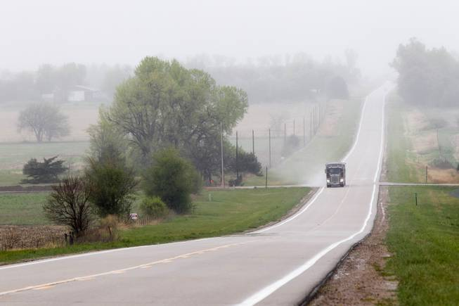 This April 19, 2012, file photo shows a truck traveling along Highway 14, several miles north of Neligh, Neb., near the proposed new route for the Keystone XL pipeline. The US is extending indefinitely the amount of time federal agencies have to review the Keystone XL pipeline, the State Department said Friday.