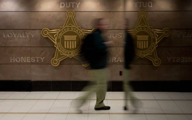 In this Feb. 20, 2014, photo, a man walks through a hall at Secret Service offices in Washington, D.C. Secret Service investigators say it could take years to identify the hackers who breached Target's computer systems in December — and even longer to bring them to justice.