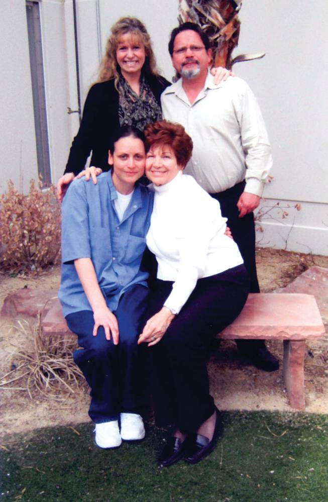 Jamie Hein, front left, is visited by her parents and Kathy Herman, front right, in prison March 6, 2010. Herman is the mother of Timothy Herman, whom Hein was convicted of murdering.