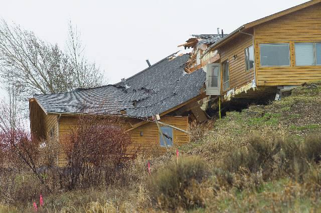 A house breaks apart as a slow-moving landslide in Jackson, Wyo. advances downhill on Friday, April 18. 2014. The slide has cut off access to a 60-person neighborhood and has threatened town utilities, including a water line.