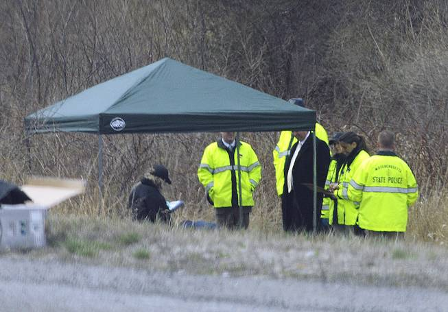 Massachusetts State Police stand along Interstate 190 where police said a child's body was found Friday, April 18, 2014, near Sterling, Mass. Jeremiah Oliver was last seen by relatives in September 2013 but wasn't reported missing until December. His mother Elsa Oliver and her boyfriend, Alberto Sierra, are charged in the case.